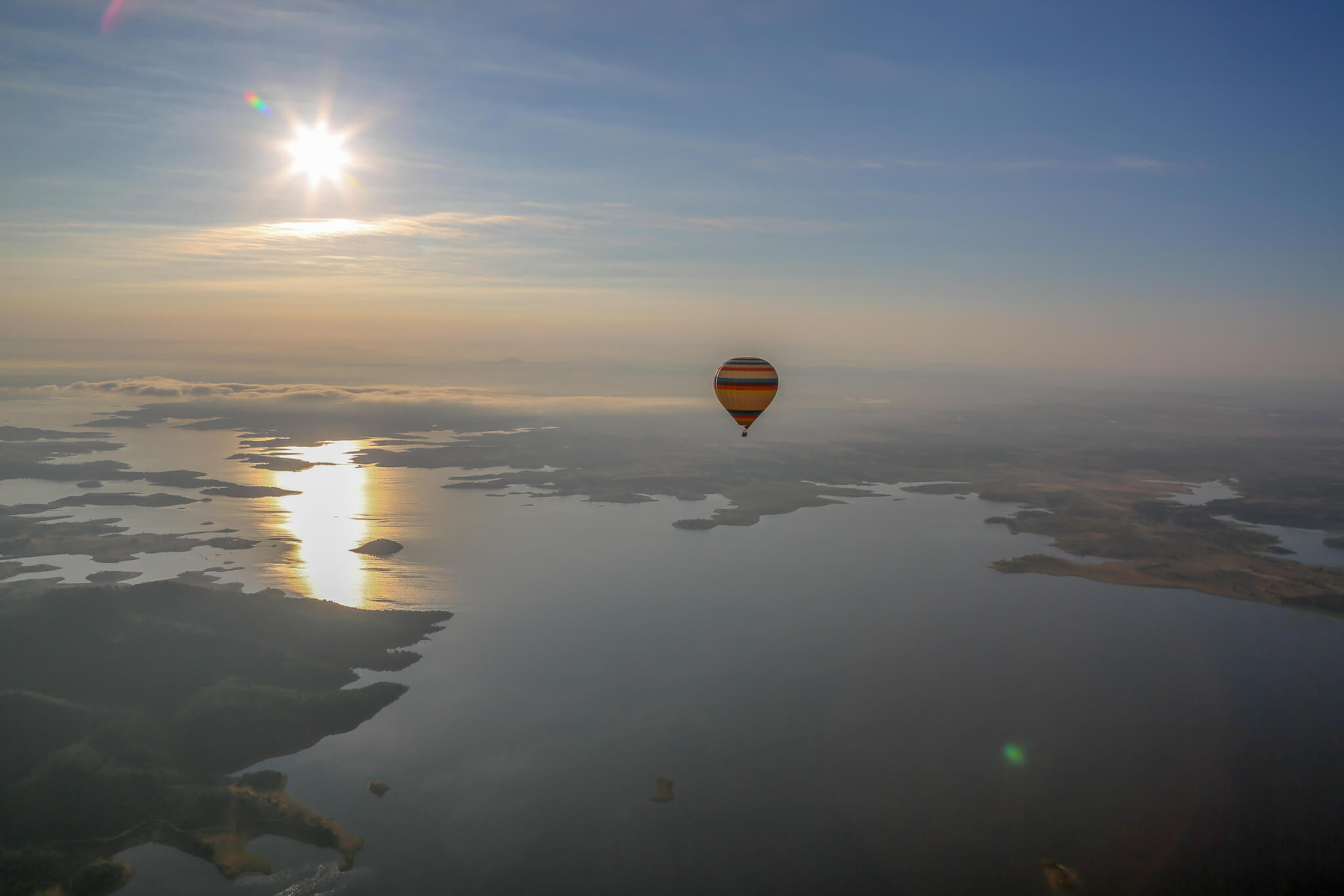 Balloon over Alqueva Reservoir at sunrise