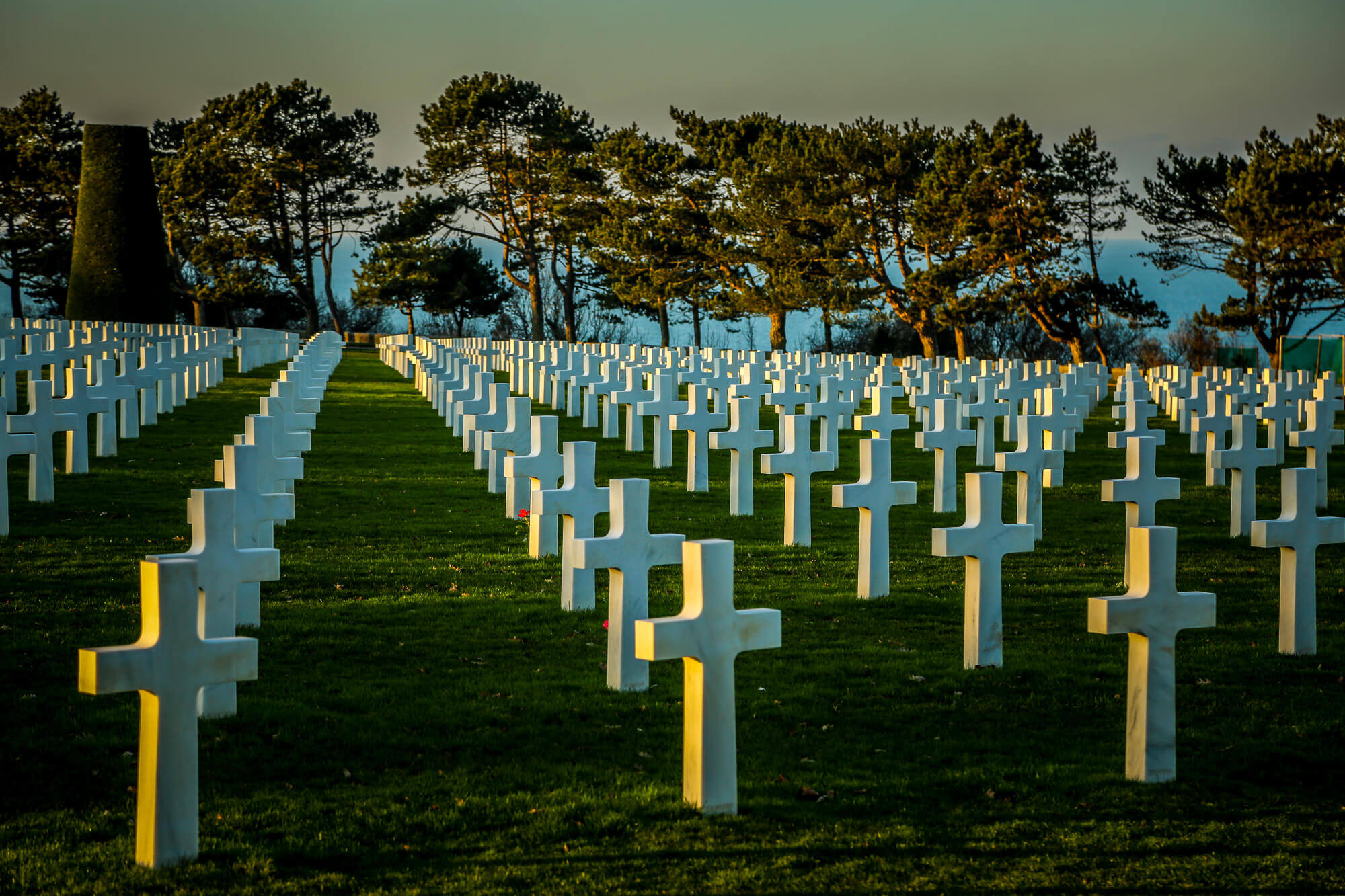Normandy American Cemetery crosses at sunset