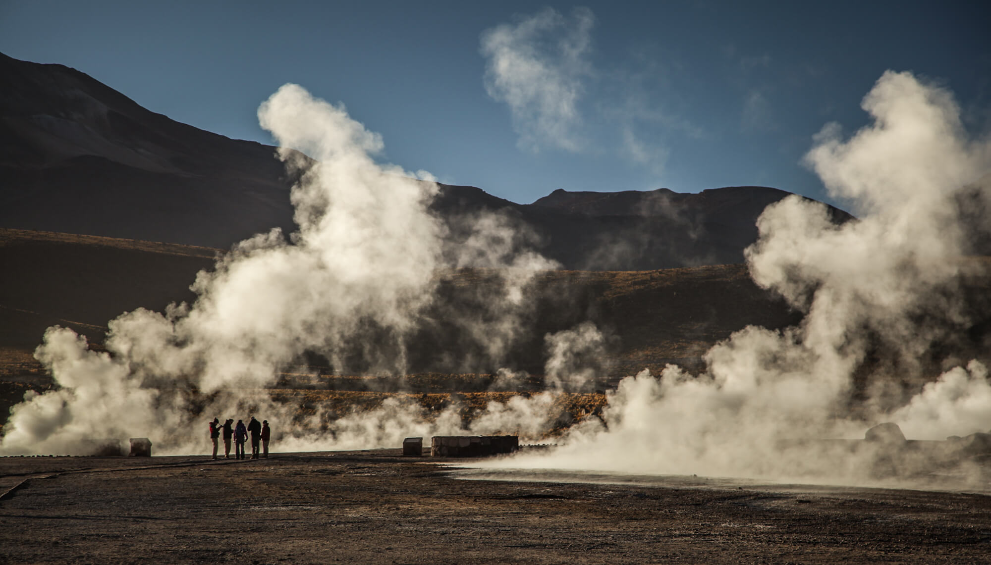 steaming geysers in morning El Tatio
